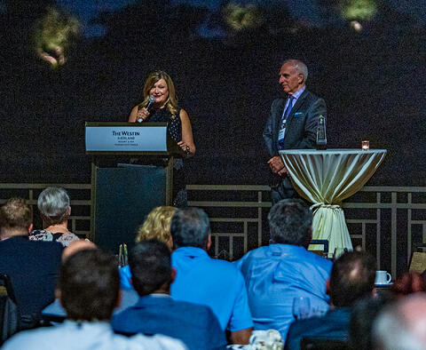 """Janice Carter Larson, CLLM, Vice President of Clinical Resources and Consulting for Encompass Group (left) accepts IAHTM """"2019 Lifetime Achievement"""" Award from IAHTM Board President Myles Noel (CEO, COMTEX)."""