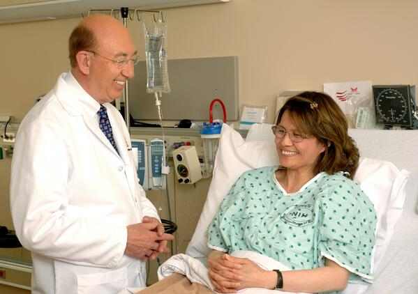 Doctor at patient bedside explaining pressure injury stages, prevention and treatment.